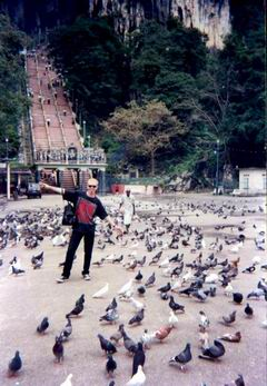 KYLE AND PIGEONS AT THE FOOT OF THE BATU STEPS
